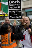 RMT protest to demand a living wage for tube cleaners, many who are migrant workers and against privatisation and the subcontracting of their jobs. Metronet HQ, Holborn. London. - Jess Hurd - 2000s,2009,activist,activists,BAME,BAMEs,Black,BME,bmes,CAMPAIGN,campaigner,campaigners,CAMPAIGNING,CAMPAIGNS,cleaner,cleaners,CLEANING,cleansing,DEMONSTRATING,demonstration,DEMONSTRATIONS,Diaspora,di