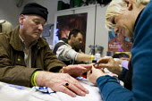 Vince a homeless man receives manicure from a volunteer. Crisis day centre opens at Bermondsey City of London Academy. Providing homeless and vulnerably housed people with a range of services and shel... - Jess Hurd - 23-12-2009