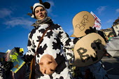 Dressed up as a methane gas producing cow, protests against COP15 United Nations Climate Change Conference, Copenhagen 2009, Denmark. - Jess Hurd - ,2000s,2009,activist,activists,against,AGRICULTURAL,agriculture,animal,animals,CAMPAIGN,campaigner,campaigners,CAMPAIGNING,CAMPAIGNS,cattle,Climate Change,Conference,conferences,costume,costumes,cow,c