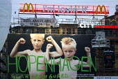 Hopenhagen branding with McDonalds. COP15 United Nations Climate Change Conference, Copenhagen 2009, Denmark. - Jess Hurd - 2000s,2009,activist,activists,advert,ADVERTISED,advertisement,advertisements,advertising,ADVERTISMENT,adverts,boy,boys,CAMPAIGN,campaigner,campaigners,CAMPAIGNING,CAMPAIGNS,catering,child,CHILDHOOD,ch