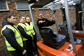 Migrant workers from Lithuania gain forklift skills. Paradise Furniture and Training for migrant workers and the unemployed. Hemel Hempstead. - Jess Hurd - 2000s,2009,adult,Adult Education,adults,agencies,agency,Diaspora,driver,drivers,driving,eastern European,edu,educate,educating,education,educational,employee,employees,Employment,foreign,Foreign Worke