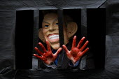 Blood on his hands and in a mock prison cell. Stop the War demonstrators dress in Blair mask as Tony Blair arrives to give testimony to the Chilcot enquiry into the Iraq war. Queen Elizabeth II Confer... - Jess Hurd - 29-01-2010