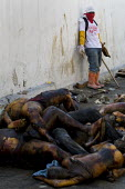Dead bodies are shovelled into a truck. Haiti earthquake. - Jess Hurd - 18-01-2010