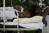 A Patient at a makeshift hospital. Haiti earthquake. - Jess Hurd - 18-01-2010