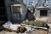 People leave dead bodies in the cemetery. Haiti earthquake. - Jess Hurd - 18-01-2010