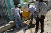 Bodies are left in the cemetery by family members. Haiti earthquake. - Jess Hurd - 18-01-2010