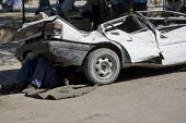 Man sleeps under his car. Haiti earthquake. - Jess Hurd - 18-01-2010