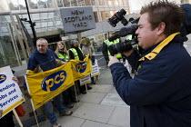 CNN filming Metropolitan Police pickets outside New Scotland Yard. PCS 48 hour strike over redundancy pay and job cuts. Westminster, London. - Jess Hurd - 09-03-2010