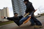 Children play at the Red Road Flats, Springburn, Glasgow. Scotland. - Jess Hurd - 2010,2010s,accommodation,Asylum Seeker,Asylum Seeker,BAME,BAMEs,Black,BME,BME Black Minority Ethnic,bmes,boy,boys,brother,brothers,CARE,carer,carers,child,childcare,CHILDHOOD,CHILDMINDING,children,cit