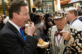 David Cameron eats fish and chips with a Pearly King on at Leadenhall Market to celebrate St George's Day. General election campaign. City of London. - Jess Hurd - 23-04-2010