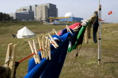 Washing line at the protest camp outside Sizewell Power Station opposing the expansion of nuclear power and supporting the alternatives. Sizewell is the site of the first new reactor. - Jess Hurd - 2010,2010s,activist,activists,against,anti,atomic,camp,CAMPAIGN,campaigner,campaigners,CAMPAIGNING,CAMPAIGNS,camps,degradation,DEMONSTRATING,demonstration,DEMONSTRATIONS,environment,environmental,gree