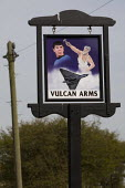 The Vulcan Arms pub sign outside Sizewell Nuclear Power Station. Named after the Vulcan bomber jet aircraft it also shows Dr Spock and the Roman god of fire and metal working - Jess Hurd - 2010,2010s,ACE,aircraft,arts,atomic,bomber,communicating,communication,culture,god,jet,LICENSED,mythologies,mythology,Nuclear,outside,pub,Public House,PUBLIC HOUSES,PUBS,radioactive,radioactivity,Roma