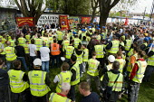 Workers on the London Olympic site stop work to join a protest march and gather to comemorate two colleagues Shaun Scurry, who were killed on the Westfield site and Henry (Harry) Sheridan who died whi... - Jess Hurd - 28-04-2010