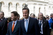 David Cameron and Nick Clegg, flanked by security walk down Whitehall from Downing Street for the Queen's speech and the state opening of Parliament. - Jess Hurd - 25-05-2010