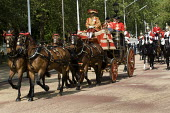 Queen rides in her horse drawn coach from Buckingham Palace to deliver the Queens speech at the state opening of Parliament. - Jess Hurd - 25-05-2010