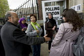 George Galloway, Respect greets voters. General Election polling station, Poplar and Canning Town, Tower Hamlets. East London. - Jess Hurd - 06-05-2010