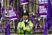 People tie purple ribbons on the gates of Parliament. Take Back Parliament protest, Demo for Democracy. Campaign for proportional representation. Westminster. - Jess Hurd - 15-05-2010