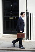 Chancellor George Osborne, leaves number 11 Downing Street to deliver his Emergency Budget to Parliament. Westminster, London. - Jess Hurd - 2010,2010s,CONSERVATIVE,Conservative Party,conservatives,deliver,Emergency,leaves,London,POL Politics,Street,Westminster