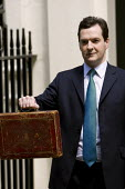 Chancellor George Osborne, leaves number 11 Downing Street to deliver his Emergency Budget. - Jess Hurd - 2010,2010s,CONSERVATIVE,Conservative Party,conservatives,deliver,Emergency,George Osborne,leaves,MP,MPs,POL Politics,politician,politicians,Street