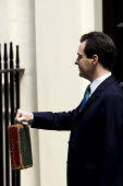 Chancellor George Osborne, leaves number 11 Downing Street to deliver his Emergency Budget. - Jess Hurd - 22-06-2010