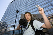 Photographer Jules Mattsson joins other colleagues celebrating a legal victory over the use of s44 of the terrorism laws outside New Scotland Yard. Organised by Im a Photographer Not a Terrorist. Lond... - Jess Hurd - 04-07-2010