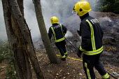 London firefighters attend a compost fire in Tower Hamlets Cemetery. East London. - Jess Hurd - 2010,2010s,adult,adults,arson,cities,city,CLJ Crime Law & Justice,DIA,Emergency Services,employee,employees,Employment,fire,fire and rescue,Fire Brigade,firefighter,firefighters,firefighting,fireman,f