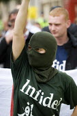 Woman wears an Infidel t-shirt and balaclava on a march to ban the Burka organised by the English Nationalist Alliance and supported by the English Defence League. Westminster, London. - Jess Hurd - 31-07-2010