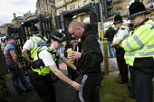 Police metal detectors. English Defence League march in Bradford. - Jess Hurd - ,2010,2010s,activist,activists,adult,adults,bigotry,CAMPAIGN,campaigner,campaigners,CAMPAIGNING,CAMPAIGNS,CLJ,crime prevention,Defence,DEFENSE,DEMONSTRATING,demonstration,DEMONSTRATIONS,DISCRIMINATION