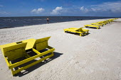 Almost deserted Biloxi beach with empty seats after the BP Deepwater Horizon oil spill. Biloxi. Mississippi. USA. - Jess Hurd - 19-08-2010