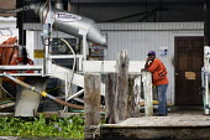BP oil spill dawn clean up operation. Grand Isle beach, Louisiana. USA. - Jess Hurd - 2010,2010s,African American,African Americans,America,BAME,BAMEs,beach,BEACHES,black,blowout,BME,bmes,BP,cleanup,COAST,coastal,coasts,dawn,Deepwater Horizon,DIA,disaster,DISASTERS,diversity,EBF,Econom