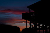 Sunset on Grand Isle, a fishing community severely affected by the BP oil spill. Louisiana. USA. - Jess Hurd - 21-08-2010