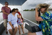LA Times reporter photographs Mike and Tracey a fishing family in Bayou Barataria badly affected by the BP oil spill. Louisiana. USA. - Jess Hurd - 2010,2010s,adult,adults,America,blowout,bluetooth,BP,camera,cameras,child,CHILDHOOD,children,communicating,communication,COMPUTE,computer,computers,COMPUTING,Deepwater Horizon,DIA,disaster,DISASTERS,e