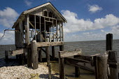 A fishing community in Barataria Bay which has been destroyed by erosion from the oil pipelines and Katrina. Louisiana. USA. - Jess Hurd - 22-08-2010