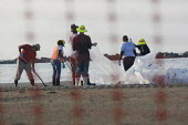 Workers on the beach clean up operation after the Gulf of Mexico BP oil spill. Grand Isle, Louisiana. USA. - Jess Hurd - 10-08-2010