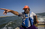 Disabled fisherman shows the damage from the Gulf of Mexico BP oil spill. Grand Isle, Louisiana. USA. - Jess Hurd - 10-08-2010