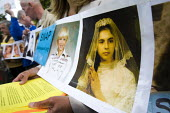 Protesters with childhood photographs of abuse victims, protesting against the visit of Pope Benedict XVI. London. - Jess Hurd - 17-09-2010