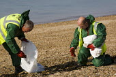 """Oil clean-up operation by Southend Borough Council workers after 500 litres of """"heavy duty oil"""" leaked from a ship into the Thames Estuary. Southend, Essex. - Jess Hurd - 21-09-2010"""