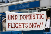 End Domestic Flights Now. Demonstrators against high emission forms of transport where viable alternatives exist. London City Airport. Newham, East London. - Jess Hurd - 04-09-2010