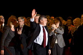 Gordon Brown farewell speech. Labour Party Conference. Manchester. Waving goodbye as he passes Harriet Harman and former leader Neil Kinnock - Jess Hurd - 25-09-2010