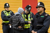 Police stop and search a young asian man. English Defence League protest. Leicester. - Jess Hurd - 09-10-2010