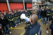 Firefighters mass picket at Poplar Fire Station. FBU members walkout over new contracts, shift working and mass sackings. Tower Hamlets, East London. - Jess Hurd - 2010,2010s,adult,adults,DISPUTE,DISPUTES,FBU,Fire,fire brigade,FIREFIGHTER,firefighter firefighters,Firefighters,fireman,firemen,fires,INDUSTRIAL DISPUTE,industrial relations,mass,MATURE,member,member