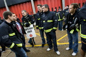 Firefighters mass picket at Poplar Fire Station. FBU members walkout over new contracts, shift working and mass sackings. Tower Hamlets, East London. - Jess Hurd - 2010,2010s,adult,adults,communicating,communication,conversation,conversations,dialogue,discourse,DISCUSS,discusses,discussing,discussion,DISPUTE,DISPUTES,FBU,Fire,fire brigade,FIREFIGHTER,firefighter