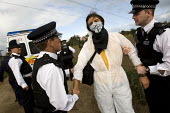 Crude Awakening. Climate activists blockade the Coryton oil refinery in Essex. - Jess Hurd - 2010,2010s,activist,activists,adult,adults,against,anti,arrest,arrested,arresting,blockade,BLOCKADING,CAMPAIGN,campaigner,campaigners,CAMPAIGNING,CAMPAIGNS,civil disobedience,Climate Change,CLJ,DEMONS