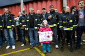 Dont sack my daddy. Firefighters mass picket at Poplar Fire Station. FBU members walkout over new contracts, shift working and mass sackings. Tower Hamlets, East London. - Jess Hurd - 2010,2010s,adult,adults,child children,DISPUTE,DISPUTES,FBU,Fire,fire brigade,FIREFIGHTER,firefighter firefighters,Firefighters,fireman,firemen,fires,girl girls,INDUSTRIAL DISPUTE,industrial relations