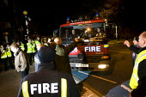 Matt Wrack, FBU Gen Sec attempts to speak to strikebreakers. FBU members picket the LFB Southwark Training Centre where scab firefighters are returning from strikebreaking. South London. - Jess Hurd - 01-11-2010
