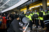 Riot police use batons as students lay seige to Tory Headquarters. UCU NUS National Demonstration for Education marches to Conservative Pary Headquarters, Millbank Tower, London to protest against pla... - Jess Hurd - 2010,2010s,activist,activists,adult,adults,against,Austerity Cuts,CAMPAIGN,campaigner,campaigners,CAMPAIGNING,CAMPAIGNS,CLJ,confront,confrontation,confronted,confronting,DEMONSTRATING,Demonstration,DE