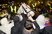 Students attempt to pat horses engaged in police charges. Protest against education cuts and increased tuition fees, Whitehall London. - Jess Hurd - 2010,2010s,activist,activists,adult,adults,against,animal,animals,Austerity Cuts,CAMPAIGN,campaigner,campaigners,CAMPAIGNING,CAMPAIGNS,CLJ,conflict,conflicts,confront,confrontation,confronted,confront