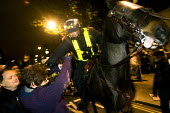 Police officer on horseback attacks a student. Police charging a protest against education cuts and increased tuition fees, Whitehall London. - Jess Hurd - ,2010,2010s,activist,activists,adult,adults,against,animal,animals,attack,attacking,Austerity Cuts,CAMPAIGN,campaigner,campaigners,CAMPAIGNING,CAMPAIGNS,charging,CLJ,conflict,conflicts,confront,confro
