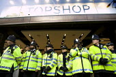 Police guarding Topshop. UK Uncut - Big Society Revenue and Customs, campaign for companies to pay tax. Topshop, London. Protest at the Arcadia group, owned by Sir Philip Green, which they say is avoi... - Jess Hurd - 04-12-2010