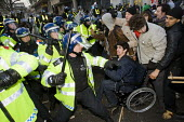 Day X. Riot police attack students including a young disabled man in a wheelchair. Students protest outside Parliament as MPs voted to increase tuition fees. London - Jess Hurd - 09-11-2010
